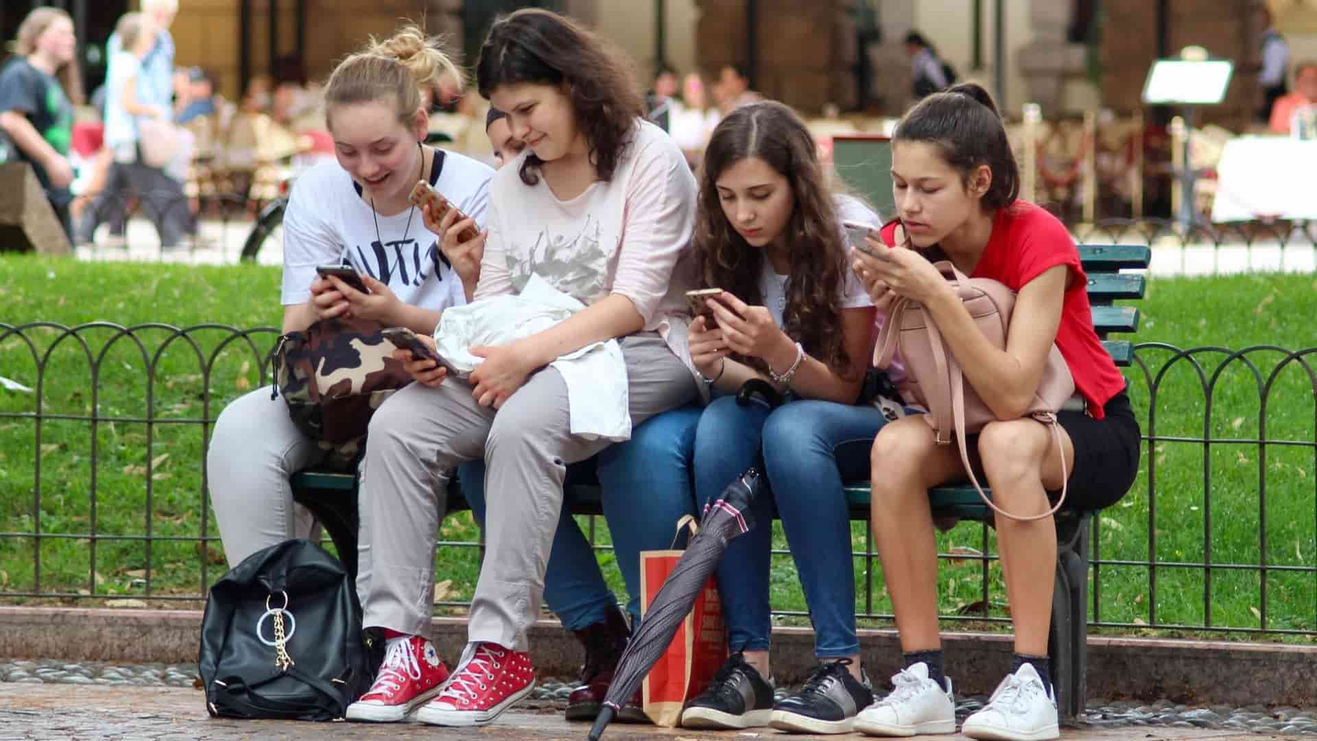 girls cell phones sitting